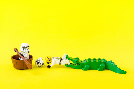 Nonthabure, Thailand - July, 07, 2016: Lego star wars ferried escaped crocodile bite.The lego Star Wars mini figures from movie series.Lego is an interlocking brick system collected around the world. Editorial