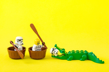 Nonthabure, Thailand - July, 07, 2016: Lego star wars ferried escaped crocodile bite.The lego Star Wars mini figures from movie series.Lego is an interlocking brick system collected around the world. Редакционное