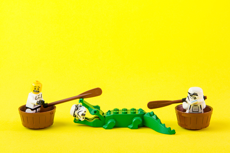escaped: Nonthabure, Thailand - July, 07, 2016: Lego star wars ferried escaped crocodile bite.The lego Star Wars mini figures from movie series.Lego is an interlocking brick system collected around the world. Editorial