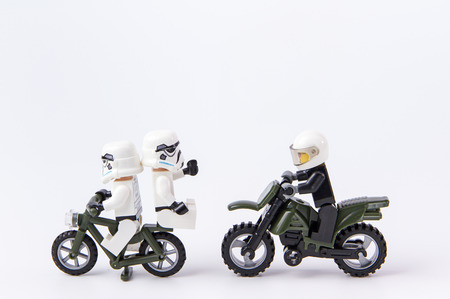 a white police motorcycle: Nonthabure, Thailand - June, 28, 2016: Lego star wars cycling escape police.The lego Star Wars mini figures from movie series.Lego is an interlocking brick system collected around the world.