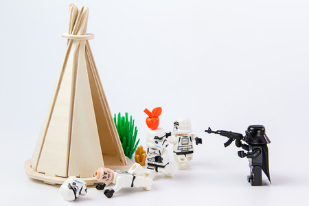 collectible: Nonthabure, Thailand - June, 28, 2016: Lego star wars test precision putting an apple on head.The lego Star Wars mini figures from movie series.Lego is an interlocking brick system collected around the world.