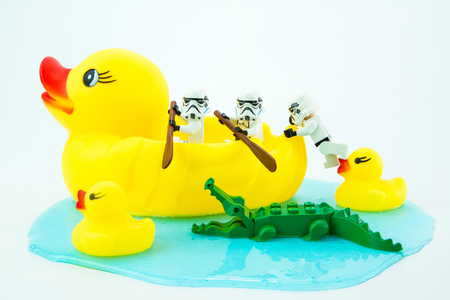 Nonthabure, Thailand - July, 10, 2016: Lego star wars paddle yellow rubber duck escaped crocodile bite.The lego Star Wars mini figures from movie series.Lego is an interlocking brick system collected around the world.