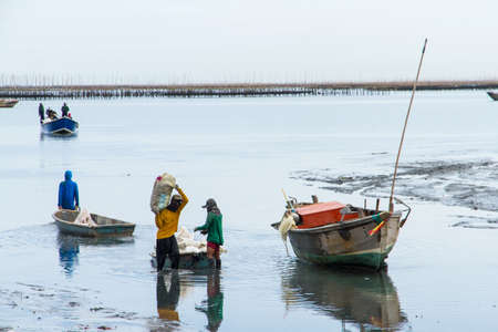 returned: The fishermen returned to shore from fishing in the morning