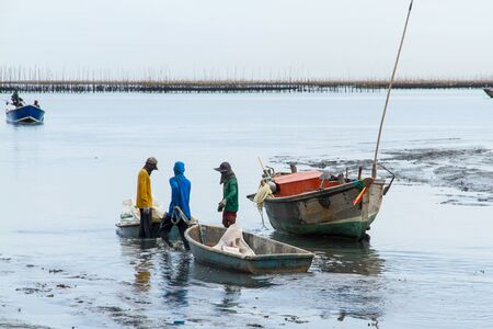 The fishermen returned to shore from fishing in the morning