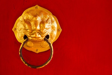 China red door with steel door knocker, this have space for text. Stock Photo