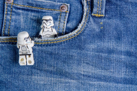 Nonthabure, Thailand - May, 05, 2016: Lego star wars in the pocket jeans.The lego Star Wars mini figures from movie series.Lego is an interlocking brick system collected around the world.