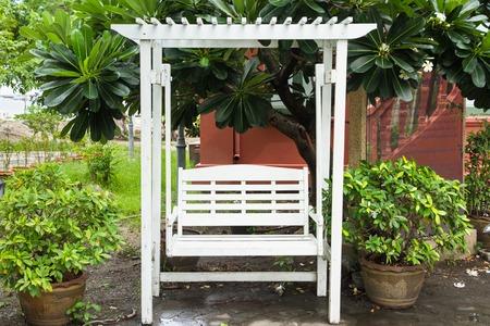 garden bench: White Garden Bench Stock Photo