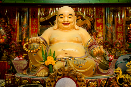 smiling buddha: Smiling Buddha - Chinese God of Happiness, Wealth and Lucky. Editorial