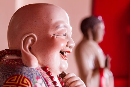 smiling buddha: Smiling Buddha - Chinese God of Happiness, Wealth and Lucky. Stock Photo