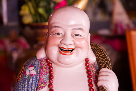 Smiling Buddha - Chinese God of Happiness, Wealth and Lucky. Stock Photo