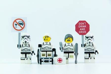 Nonthabure, Thailand - August, 08, 2016 : Lego star wars stand holding a sign Drink dont drive and Lego accident by a drunk driver. isolated on white background.Lego is an interlocking brick system collected around the world. Editorial