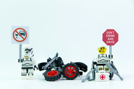 dont drink and drive: Nonthabure, Thailand - August, 08, 2016 : Lego star wars stand holding a sign Drink dont drive and Lego accident by a drunk driver. isolated on white background.Lego is an interlocking brick system collected around the world. Editorial