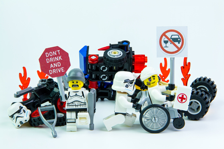drink and drive: Nonthabure, Thailand - August, 08, 2016 : Lego star wars accident by a drunk driver. holding a sign Drink dont drive isolated on white background.Lego is an interlocking brick system collected around the world.