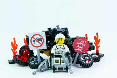 dont drink and drive: Nonthabure, Thailand - August, 08, 2016 : Lego star wars stormtrooper accident by a drunk driver and a sign Drink dont drive. isolated on white background.Lego is an interlocking brick system collected around the world.