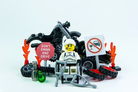Nonthabure, Thailand - August, 08, 2016 : Lego star wars stormtrooper accident by a drunk driver and a sign Drink dont drive. isolated on white background.Lego is an interlocking brick system collected around the world.
