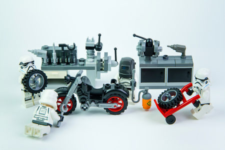 mini bike: Nonthabure, Thailand - August, 08, 2016 : Lego star wars stormtrooper was motorcycle repair technician. isolated on white background.Lego is an interlocking brick system collected around the world.
