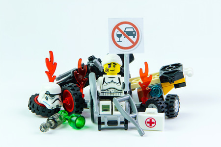 dont drink and drive: Nonthabure, Thailand - August, 08, 2016 : Lego star wars accident by a drunk driver. holding a sign Drink dont drive isolated on white background.Lego is an interlocking brick system collected around the world.