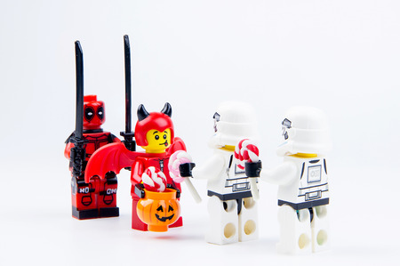 Nonthabure, Thailand - September, 24, 2016 : Lego ghost halloween and Lego deadpool want halloween candy Trick or Treat with Lego star wars stormtrooper.Theme Halloween background. Editorial
