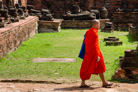 Ayutthaya, Thailand - October, 21, 2016 : Unidentified name buddhist monk walks tourist to visit at Wat Mahathat, Ayutthaya, Thailand Editorial