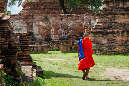 Ayutthaya, Thailand - October, 21, 2016 : Unidentified name buddhist monk walks tourist to visit at Wat Mahathat, Ayutthaya, Thailand Editorial