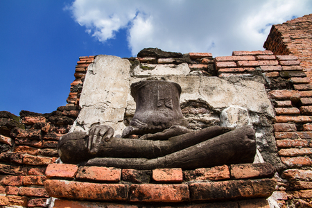 Ayutthaya, Thailand - October, 21, 2016 : Ancient buddha statues damaged at Wat Mahathat, Ayutthaya, Thailand