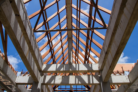 Low angle view of roof trusses and framing wooden of new house construction. Stock Photo