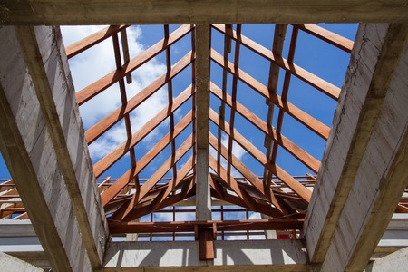 roof framing: Low angle view of roof trusses and framing wooden of new house construction. Stock Photo