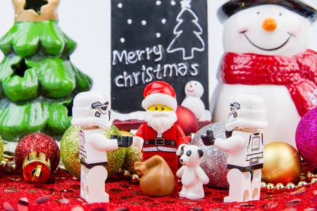 stormtrooper: Nonthaburi, Thailand - November, 04, 2016 : Lego Santa Claus giving gifts to Lego star wars stormtrooper at Christmas.Theme Christmas day background.