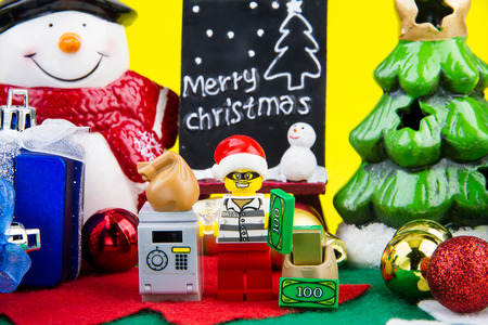 stole: Nonthaburi, Thailand - November, 04, 2016 : Lego thief dressed as Santa Claus stole money and gold in a safe everybody at Christmas.Theme Christmas day background.
