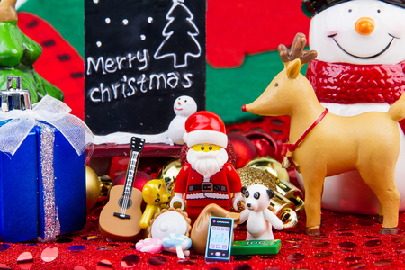 distributed: Nonthaburi, Thailand - November, 04, 2016 : Lego Santa Claus giving gifts bring the distributed to everybody at Christmas.Theme Christmas day background.