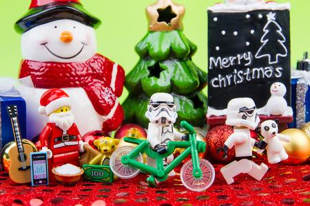 mini bike: Nonthaburi, Thailand - November, 04, 2016 : Lego Santa Claus giving gifts to Lego star wars stormtrooper at Christmas.Theme Christmas day background.
