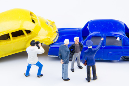Miniature tiny toys car crash accident damaged.Accident on the road background
