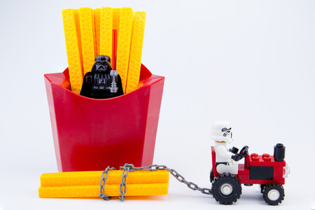 Nonthaburi, Thailand - November, 19, 2016: Lego star wars stormtrooper were carrying toys french fries plastic from red package.Lego is an interlocking brick system collected around the world.