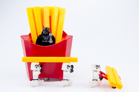 stormtrooper: Nonthaburi, Thailand - November, 19, 2016: Lego star wars stormtrooper were carrying toys french fries plastic from red package.Lego is an interlocking brick system collected around the world.