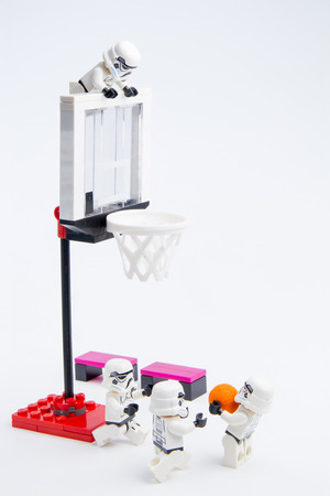 stormtrooper: Nonthaburi, Thailand - November, 19, 2016: Lego star wars stormtrooper playing basketball at basketball court.Sports background.Lego is an interlocking brick system collected around the world.