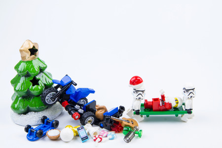 overturn: Nonthabure, Thailand - November, 21, 2016 : Lego stormtrooper taken lego Santa Claus accident motorcycle crash christmas tree  while distribution gifts at christmas to hospital.Theme Christmas day background.