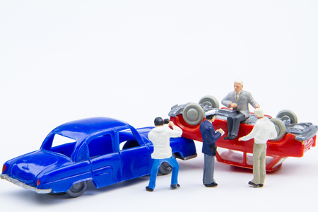 Miniature tiny toys car crash accident damaged.Insurance on the road.Driving safety do not underestimate.Accident on the road background