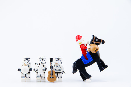 Nonthaburi, Thailand - November, 26, 2016 : Lego Santa Claus ride a horse giving gifts to Lego star wars stormtrooper at Christmas.Theme Christmas day background. Editorial