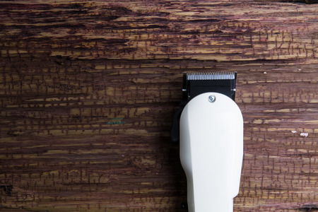 clippers: Stylish Professional Barber Clippers, Hair Clippers, Haircut accessories on wood background with copy space