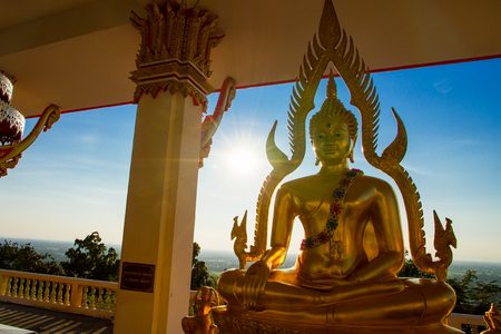 Buddha in a temple at evening sunset background.Thailand. Editorial
