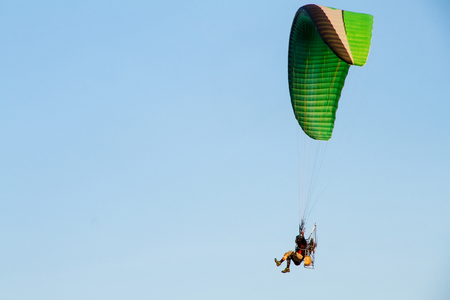 Paramotor, Parachute, Paraglide flying in the sunset sky Stock Photo