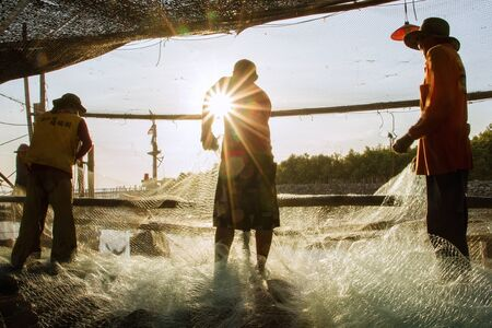 Samut Prakan, Thailand - December, 24, 2016 : Unidentified Fishermen collect the nets after the boat to shore at Khlong Ta Kok Bang Pu Samut Prakan, Thailand Editorial
