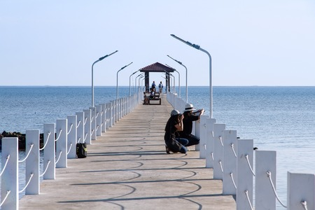 Samut Prakan, Thailand - December, 24, 2016 : Unidentified Tourist visit white cement bridge fishing pier extending into the sea at Khlong Ta Kok Bang Pu Samut Prakan, Thailand. Editorial