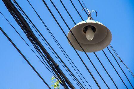 Street lamp & wire on blue sky.