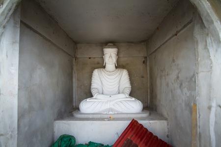 bodhgaya: White Buddha Statue in Bodhgaya Stupa or Phuthakaya Pagoda at Sangklaburi, Kanchanaburi, Thailand.