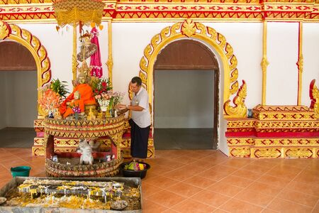 bodhgaya: Kanchanaburi, Thailand - December, 26, 2016 : Unidentified Man dressed native at Bodhgaya Stupa or Phuthakaya Pagoda at Sangklaburi, Kanchanaburi, Thailand