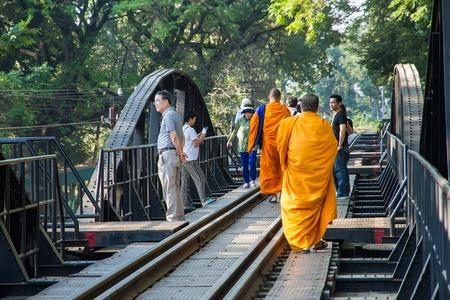 Kanchanaburi, Thailand - December, 25, 2016 : Unidentified Monk walk on The Railway Bridge on the River Kwai at Kanchanaburi,Thailand.This bridge is famous for its history in second world war.