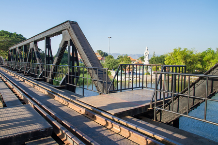 Kanchanaburi, Thailand - December, 25, 2016 : Unidentified Tourist walk on The Railway Bridge on the River Kwai at Kanchanaburi,Thailand.This bridge is famous for its history in second world war