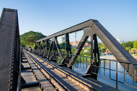 Kanchanaburi, Thailand - December, 25, 2016 : Unidentified Tourist walk on The Railway Bridge on the River Kwai at Kanchanaburi,Thailand.This bridge is famous for its history in second world war