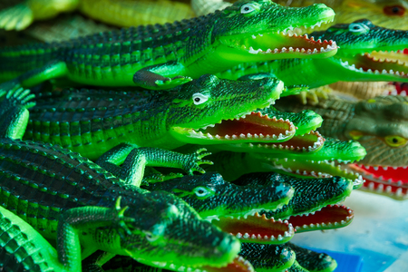 destructive: Close up Crocodile green rubber toy for children. Stock Photo